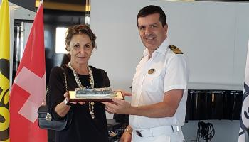 1.	Honorary Consul for Italy in Barbados, Paola Baldi-Lussan (left) receives a model of the ship from Captain Stefano Battinelli.