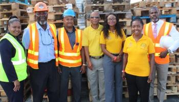 Employees of Barbados Port Inc.'s and the Rural Development Commission during the handover of the pallets.